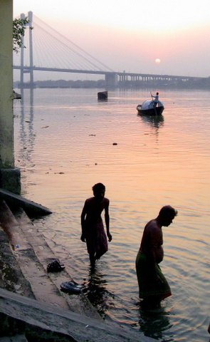 Ritual bathers in the Hooghly River at sunset